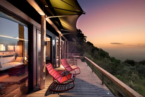 Angama's iconic red rocking chairs sit handsomely overlooking the Mara