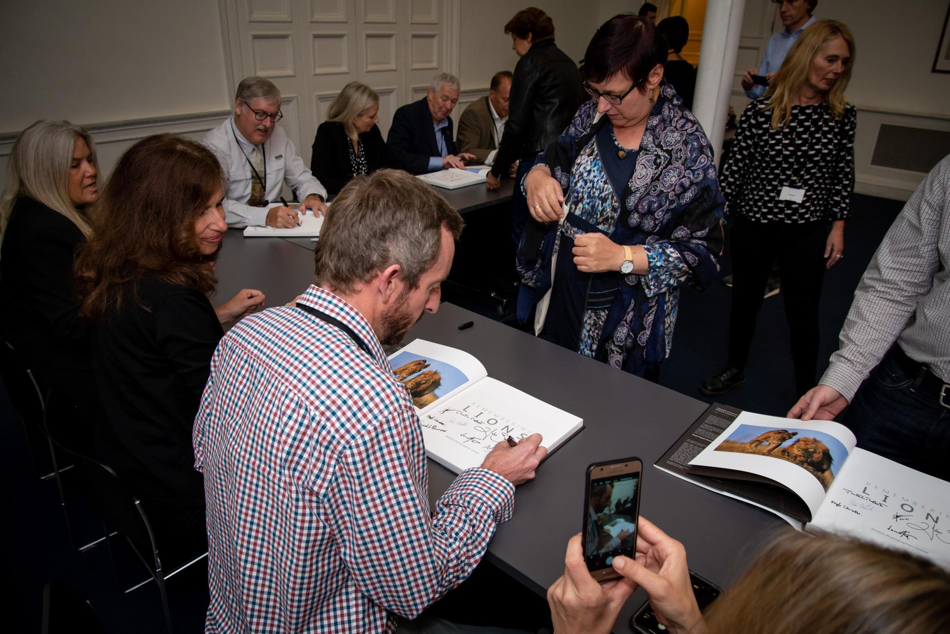 Adam Bannister, signing books