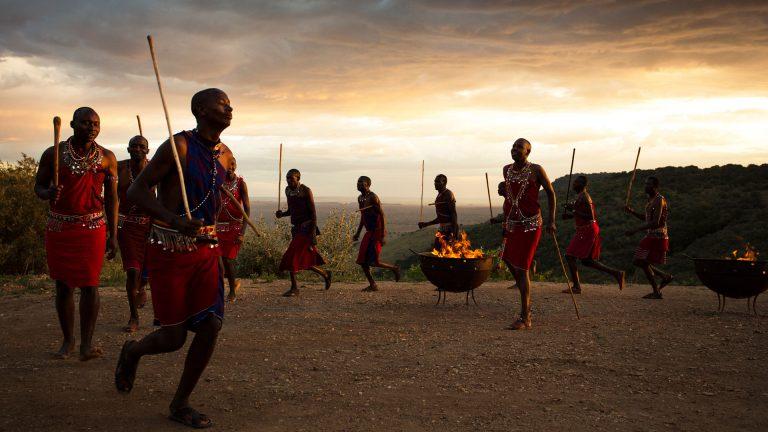 Maasai warriors dancing at sunset