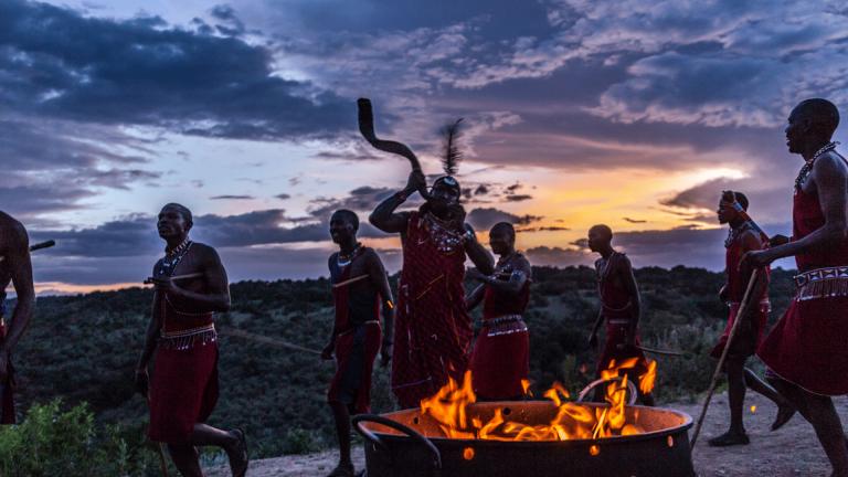 Maasai warriors dancing at Angama Mara sunset boma