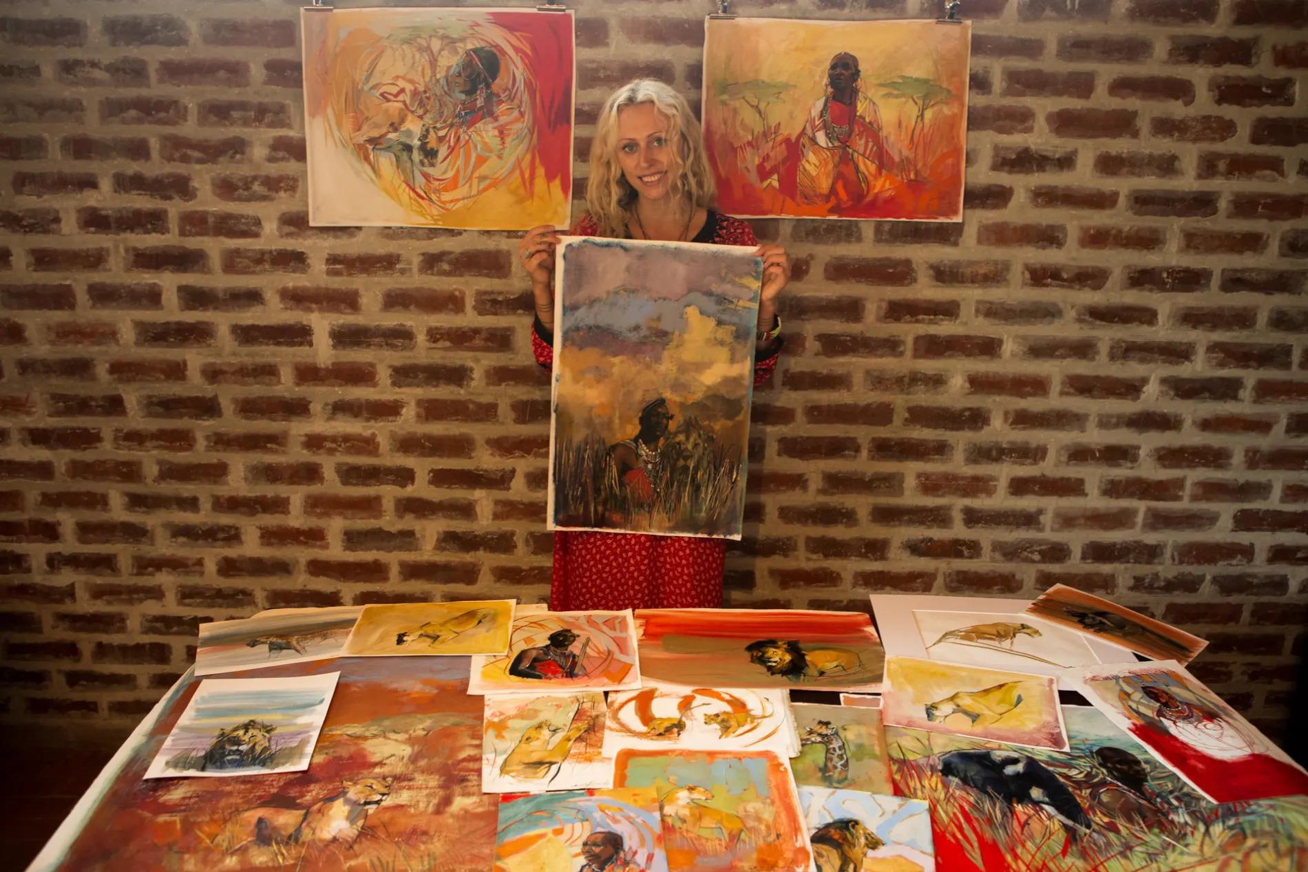 Emily Lamb holding artworks