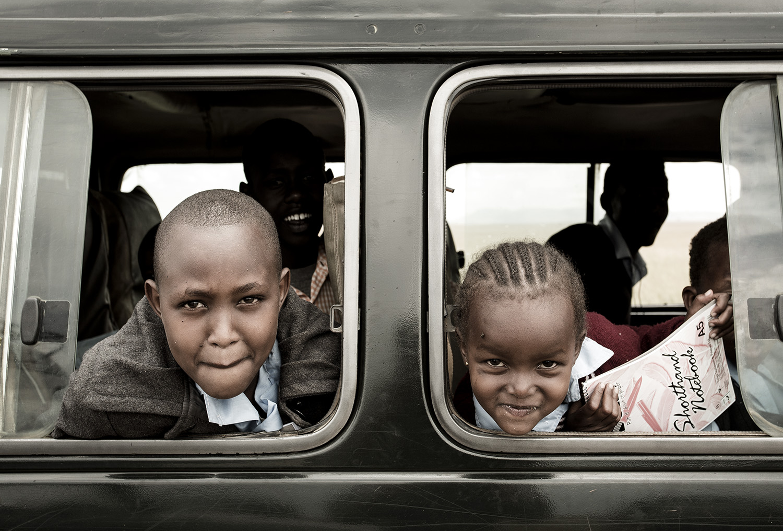 WWD kids faces out window