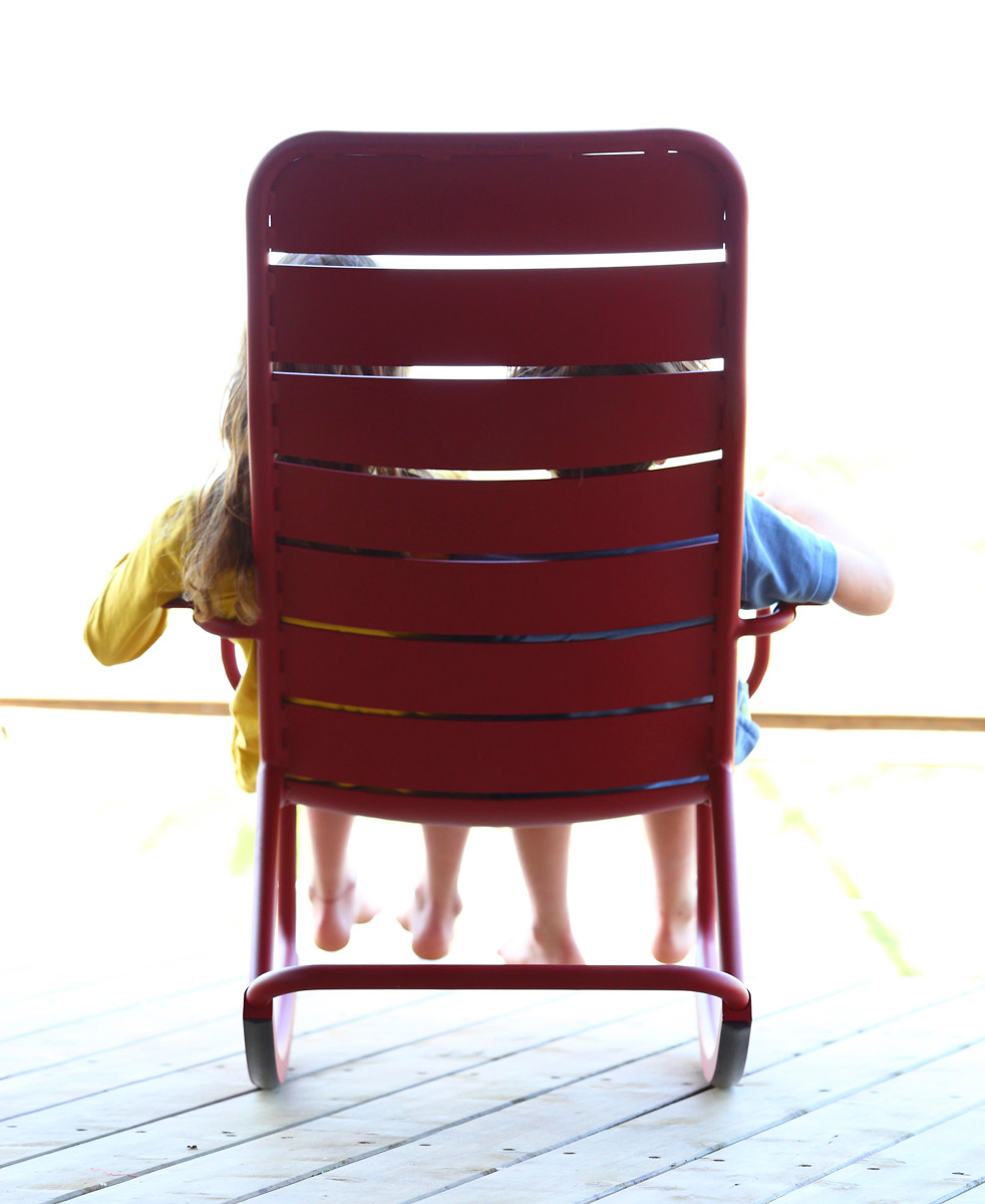 Kids on the Red Rocking Chair