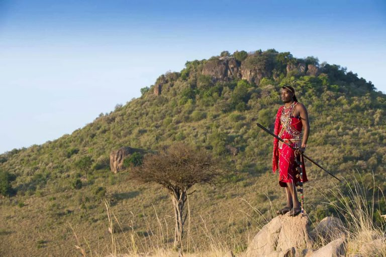 Maasai Fred with Angama Mara in the background
