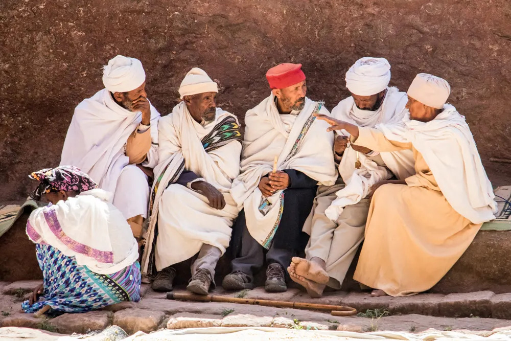 Some elders in discussion at a church in Lalibela