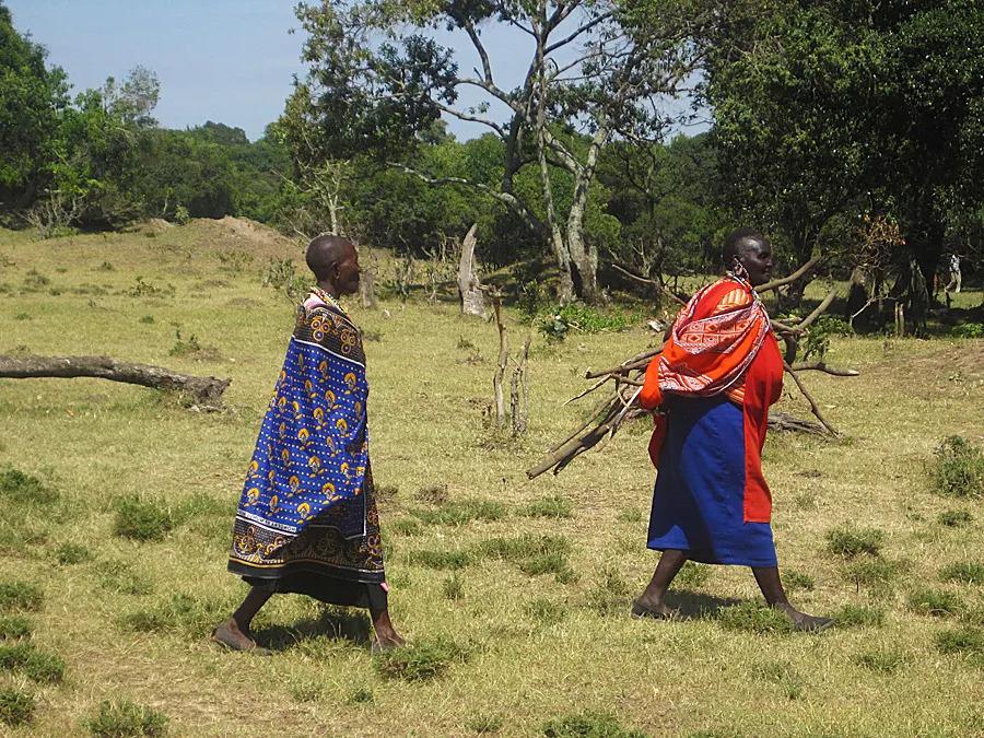 Maasai Women doing chores dressed in shukas