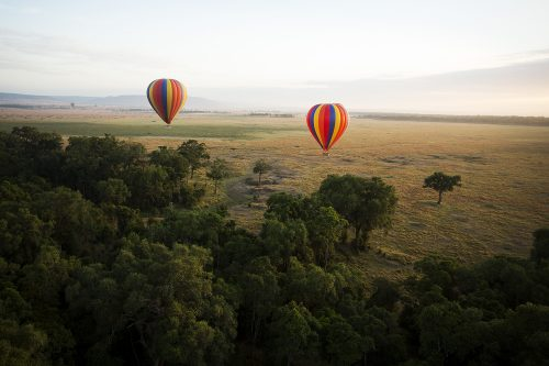 Hot air balloons float over the Mara Triangle – Adam Bannister