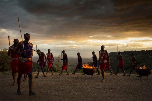 Maasai Warriors perform at sunset at Angama Mara – Adam Bannister