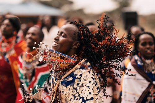 Maasai lady dancing during a ceremony – Tim Hulme