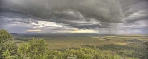 Views of a rainstorm rolling in towards Angama Mara