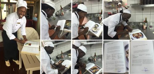 Angama chefs signing the page of their chosen recipe