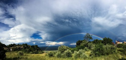 The rainbow after storm shining over the Maasai Mara