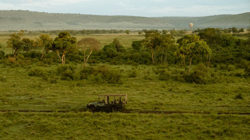 An Angama vehicle exploring the Mara as seen from a hot air balloon