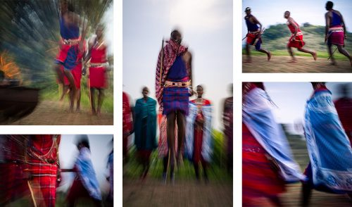 Maasai warriors sing at dance in the Angama boma at sunset