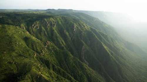 Dramatic scenery of waterfalls, gorges and forested ravines