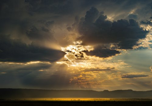 The sun sets over the Oloololo escarpment, marking another beautiful day in the Mara