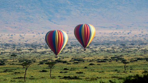 Above: True peacefulness is watching hot-air balloons floating over the Mara