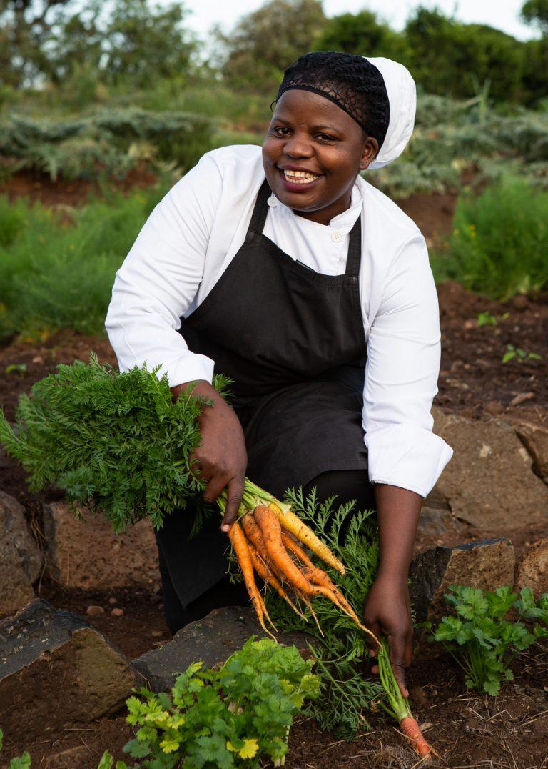 Chef Brenda fetching ingredients from Angama Mara Shamba