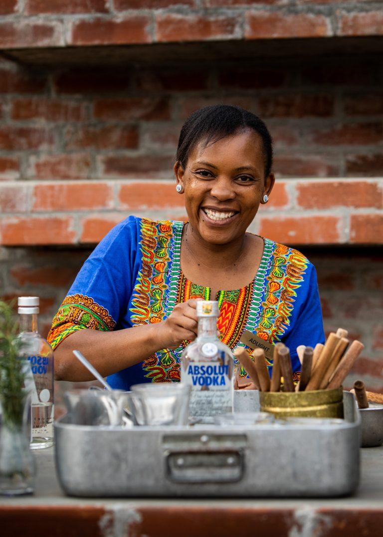 Angama Mara butler Adlight preparing drinks at sundowner boma