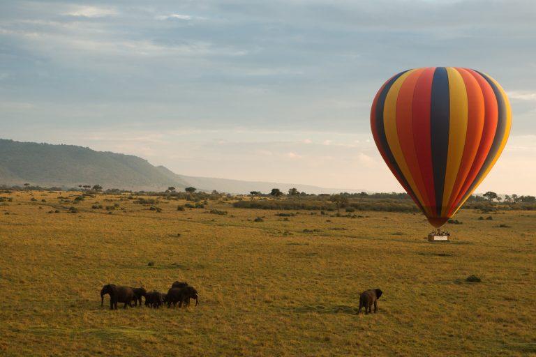 Maasai Mara scene with elephants and hot air balloon