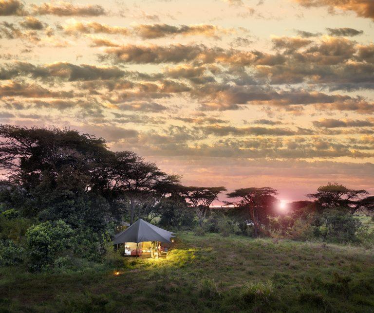 Angama Safari Camp tent lit up at sunrise