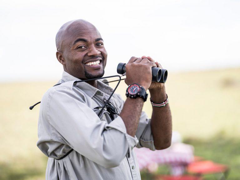 Guide Douglas with binoculars in the Maasai Mara