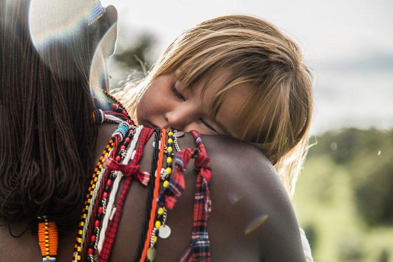 Child with Maasai Warrior in the Maasai Mara