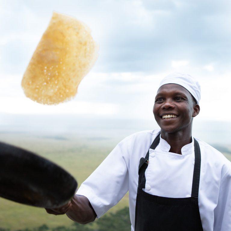 Moses Koros Angama Mara chef with pancakes
