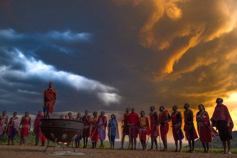 Maasai Warriors dancing at sunset Angama Mara