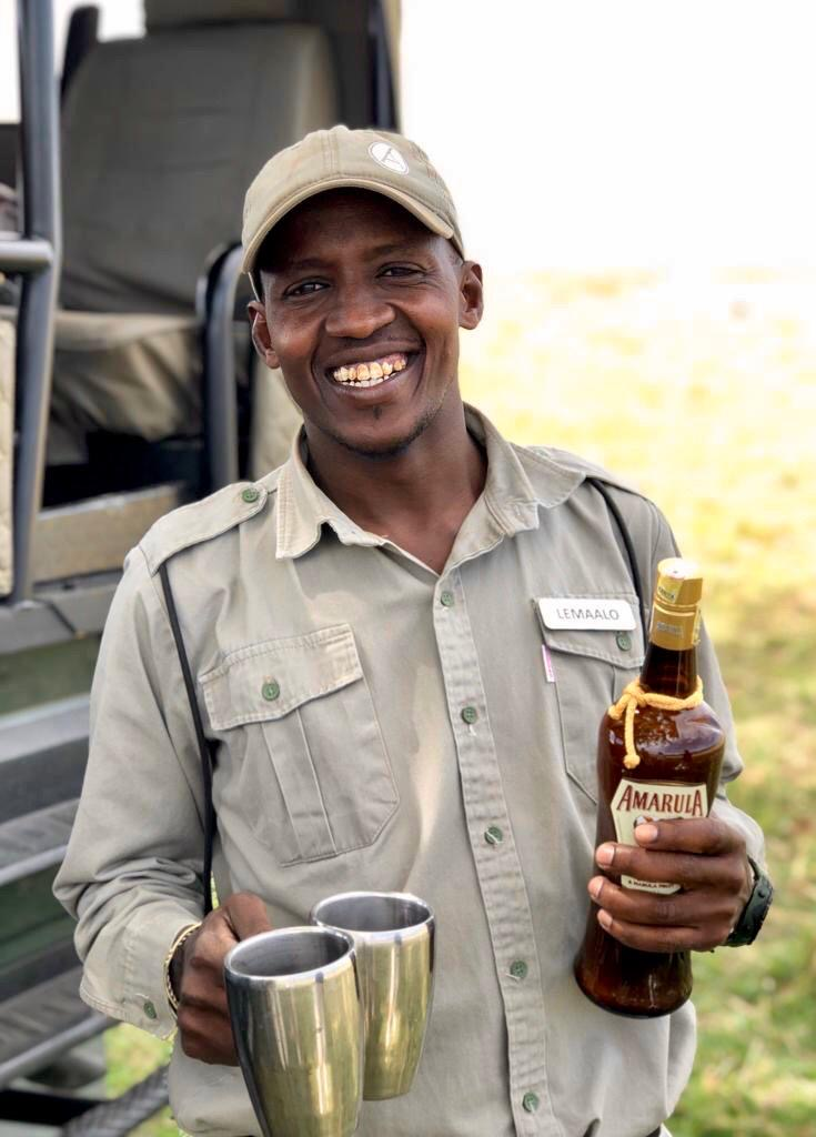 Guide Lemalo serving drinks in the Maasai Mara