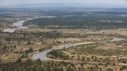 The vastly different landscape and wider river bends of Tanzania